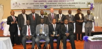 Recipients of the 2014 JLOS Recognition awards pose for a group photo with the Ag. Chief Justice and other dignitaries during the 19th annual JLOS Review held on October 30 2014 at Speke Resort and Contry Club. (PHOTO: Edgar Kuhimbisa/JLOS)