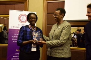 Ms. Rachel Odoi-Musoke (left), the JLOS Senior Technical Advisor receiving her award from the First Lady Janet Museveni (PHOTO: Judiciary)