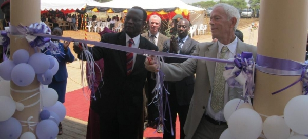 The Ag. Chief Justice, Hon. Justice Stephen Kavuma (left) and Mr. Floris Van Eijk, FirstSecretary Security and Rule of Law and the Netherlands Embassy (representing the Netherlands Ambassador) opening the Moroto JLOS House on February 14 2014 (PHOTO: JLOS Media)