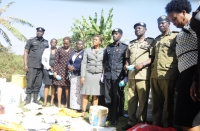 Deputy Inspector General of Police Maj. Gen. Sabiiti Muzeyi (middle) with Police officers and several officials from the Justice, Law and Order Sector witnessing the destruction of narcotics at Nsambya Police Barracks on March 14, 2019 (PHOTO: Uganda Police)