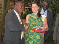 The Chief Registrar, H.W Paul Gadenya (left) handing a recognition award to Ms. Simone Ungersboeck the outgoing Governance Advisor at the Austria Development Cooperation (ADC) in Kampala on april 25 2016. (PHOTO: Edgar Kuhimbisa / JLOS)