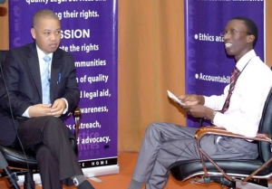 Justice Molahlehi (left) speaking to Edgar Kuhimbisa (PHOTO: JLOS)