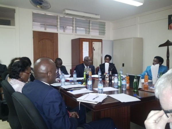Justice Lameck Mukasa, Head of  the Criminal Division of the High Court (Middle) addressing a meeting with the visiting UNICEF Legal Advisory delegation from Norway on 16 January 2014 (PHOTO: JLOS Media)