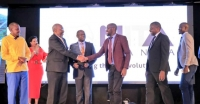 Hon. Ruhakana Rugunda the PM handing over an award at the EGovernment Excellence Awards held at Speke Resort Munyonyo on June 27 2019 (PHOTO: NITA)
