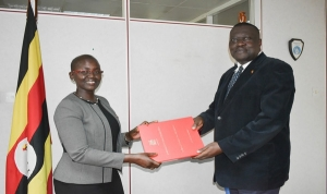 Justice Jane Frances Abodo being handed the office of the DPP by Ag. DPP Mr. Alfred Elem-Ogwal (PHOTO: ODPP)