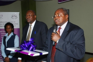 The Principal Judge, Justice Yorokamu Bamwine (centre) at the launch of the Alternative Dispute Resolution (ADR) project on March 18 2015 at Imperial Royale Hotel, Kampala. Looking on is Justice David Wangutusi (Chairperson, ADR Project Advisory Board) and Ms. Harriet Lwabi (Ag. Solicitor General).