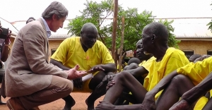 Mr Peter Launsky, the Director General for Development Cooperation in the Austrian Ministry of Foreign Affairs having a discussion with prisoners at Lira Government Prison on November 27 2014 (PHOTO: JLOS/Edgar Kuhimbisa)